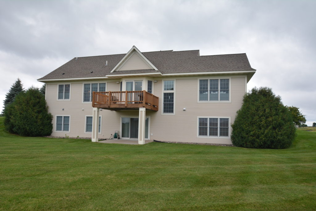 Example of a detached villa in Troy Burne Golf Village in Hudson, WI by Durham Executive Group