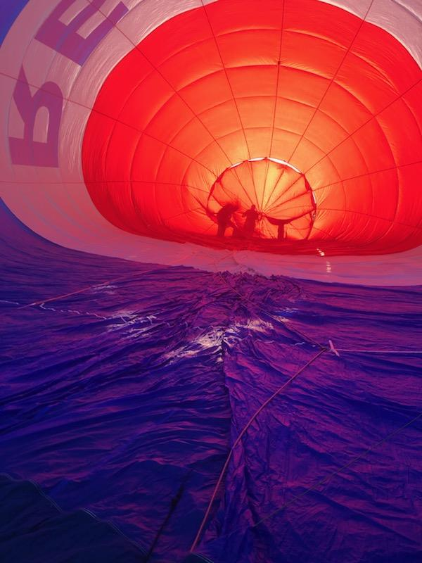 REMAX hot air balloon filling up with sunrise shining